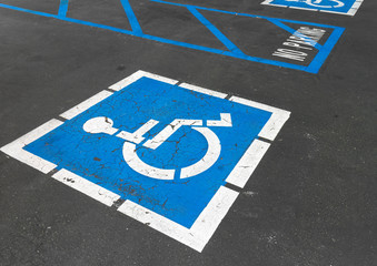 Close up of empty handicapped reserved parking space with wheelc