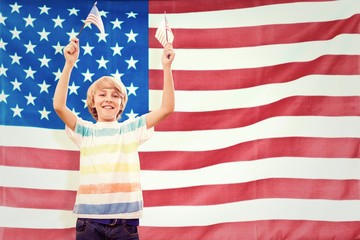 Composite image of cute boy with american flag