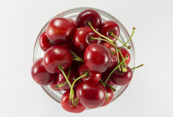 Cherries (red)  in a round glass salad bowl