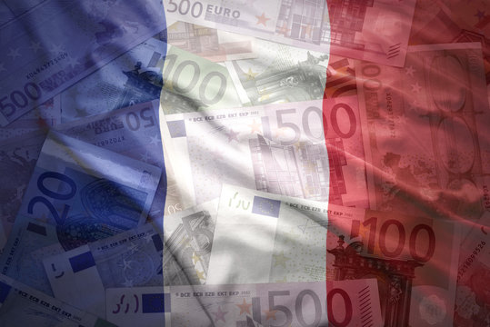 colorful waving french flag on a euro money background