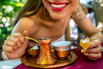 Woman with turkish coffee