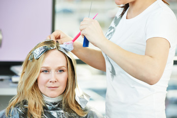 Highlight. woman hairdressing in salon