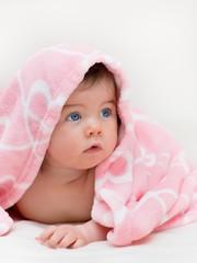 Beautiful little girl under towel
