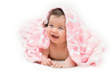 Beautiful little girl under towel