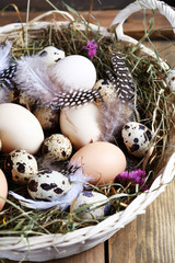 Easter basket with eggs and hay