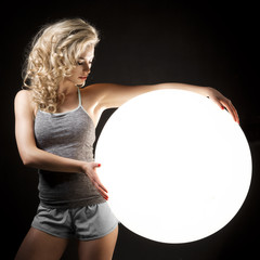 Sexy blond girl with white flash ball