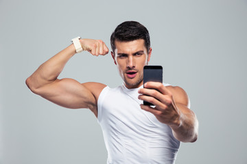 Sports man making selfie photo on smartphone