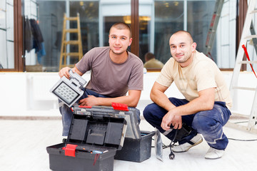 Teammate Electricians With Tool Boxes