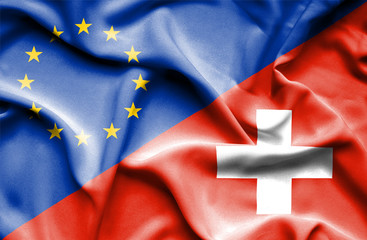 Waving flag of Switzerland and EU
