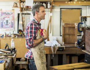 An antique furniture restorer in his workshop having a coffee break.