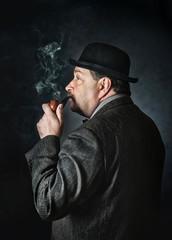 Fototapeta Retro man smoking a pipe
