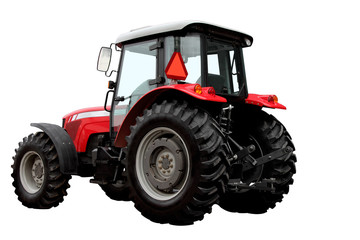 The modern red tractor is isolated on a white background