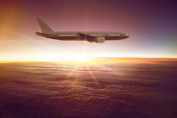 Flying Airplane in front of a sunset
