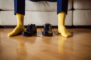 The man wears shoes. Yellow socks.
