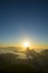 Scenic Rio de Janeiro Brazil golden sunrise over Guanabara Bay with a skyline silhouette of Sugarloaf Mountain