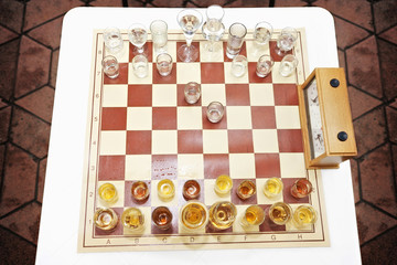 Chess set/Chess table with glass of drink