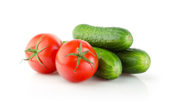 Fresh Tomatoes and Cucumbers isolated on white background