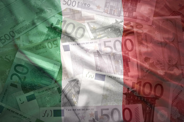 colorful waving italian flag on a euro money background
