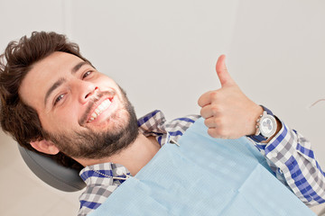 young happy man and woman in a dental examination at dentist