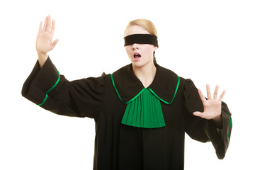 Blind justice. Woman covering eyes with blindfold