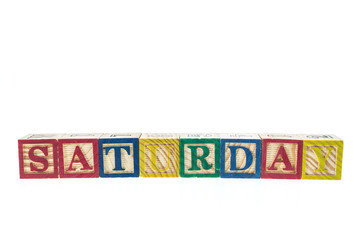 Saturday written in letter colorful alphabet blocks isolated on