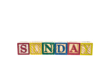 Sunday written in letter colorful alphabet blocks isolated on wh