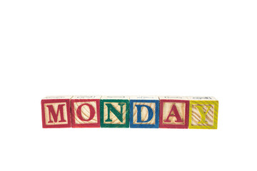 Monday written in letter colorful alphabet blocks isolated on wh