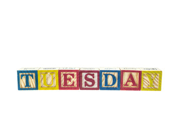 Tuesday written in letter colorful alphabet blocks isolated on w