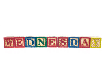 Wednes written in letter colorful alphabet blocks isolated on wh