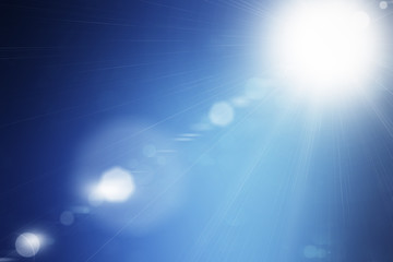 Shining summer sun flare on blue sky background