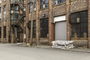 Old Sofa in front of Abandoned Building Wall mural