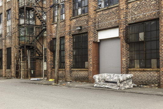 Old Sofa in front of Abandoned Building