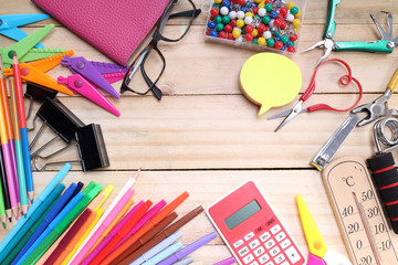 School and office stationary on wood table .  Back to school concept