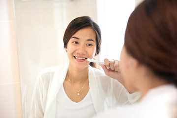 Asian young woman tooth brushing her teeth happily