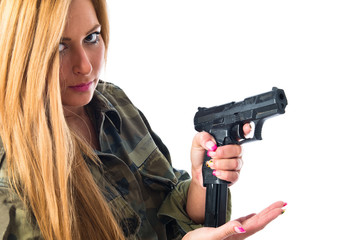 Military woman carrying a gun