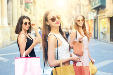 Three girls in a shopping day