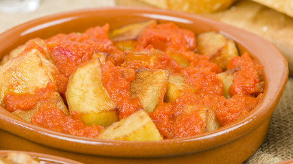 Patatas Bravas - Crispy potato chunks in spicy tomato sauce. Traditional Spanish tapas dish.