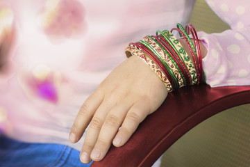 Girl's hand with bracelets