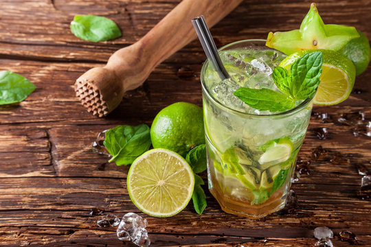 Mojito drink on wooden planks