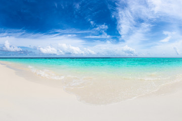 tropical paradise beach with crystal clear, turquoise blue water, wonderful clouds and sky