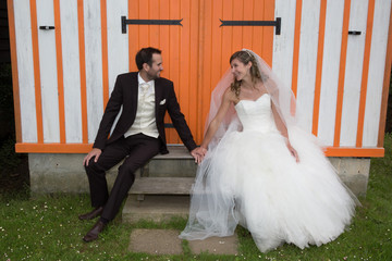 Groom and bride outside happy and in love