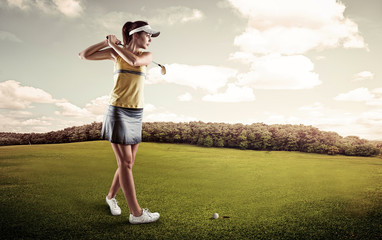 Young concentrated golf player holding club preparing for shot