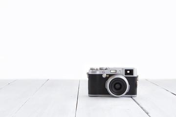 Retro style digital camera on wooden background