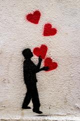 Wandmalerei Mann mit Herzen