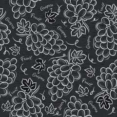 Black blackboard with grapes