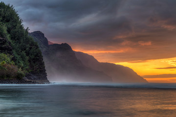 Long exposure at Sunset from Kee Beach on the Hawaiian Island of Kauai with a view of the rugged Napali coast