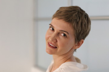 Portrait of blond woman with trendy hairstyle