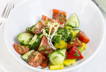vegetable salad cucumber tomato pepper with sunflower oil