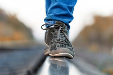 railroad rails feet sneakers
