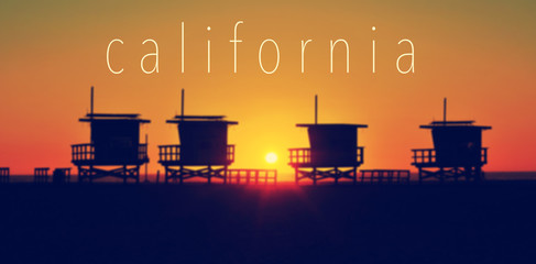 the word California and some lifeguard towers in Venice Beach at